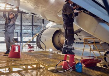 Engineers working on a wing